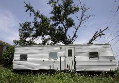 A Federal Emergency Management Agency trailer sits in front of a home in the Lakeview area of New Orleans on May 7. According to Edward Horan, the city's zoning administrator, there were 3,949 trailers throughout New Orleans as of July 1.