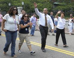Massachusetts Gov. Deval Patrick, third from left, walks with his family in a gay pride parade, Saturday, June 14 in Boston. An effort is gaining momentum to appeal a 1913 law that bans out-of-state gay couples from getting married in Massachusetts.