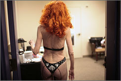 Tempest Storm walks into the dressing room after performing at the Burlesque Hall of Fame's annual All-Star Burlesque Weekend held at the Palms hotel and casino in Las Vegas in June.