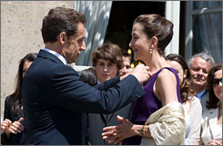 French president Nicolas Sarkozy presents former hostage Ingrid Betancourt with Frances' Legion of Honor award, during a ceremony at the Elysee Palace, Paris, on Monday.