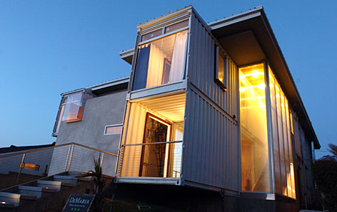 Shipping containers become distinctive housing on land usatoday com