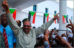The International Criminal Court in The Netherlands is charging Sudanese President Omar al-Bashir with genocide in Darfur. Here, al-Basir is seen greeting supporters at a protest rally Sunday in Khartoum after reports that the world court would seek his arrest.
