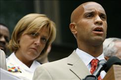 District of Columbia Chief of Police Cathy Lanier, left, listens as ...