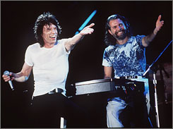 Musician, Chuck Leavell, right, pictured performing as a memeber of the Rolling Stones alongside Mick Jagger, stood in as keyboardist for Minnesota Rep. Collin Peterson's band at the House Agriculture Committee hearing room Wednesday.