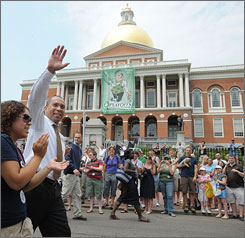 Massachusetts Gov. Deval Patrick waves during Boston's gay pride parade on June 14 as he walks with his daughter, Katherine, past the gold-domed statehouse. Katherine Patrick announced recently she is a lesbian. The state Senate has repealed a 1913 law banning gay marriage for out-of-state couples. The measure now goes before the state House.