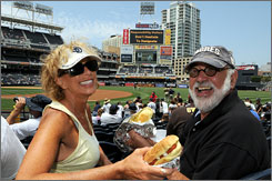 San Diego Padres fans Georgi Bohrod Gordon and Rich Gordon, who have been married since December 2006, relish their time together.