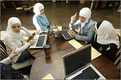 "From left, Mariam Zaiat, 22, Amani Dabaja, 18, Latifeh Sabbagh, 24, and Dewnya Bakri, 21, talk in Dearborn, Mich. ""There's a big stigma around receiving help in this community,"" so the group hopes to reach out to teens, especially, says Sabbagh."