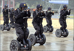 Members of the Jinan Special Weapons and Tactics team use Segways during an Olympic anti-terrorism training drill in Jinan, eastern China's Shandong province, on July 2.