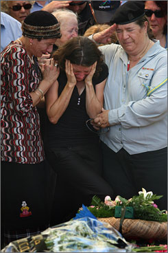 Karnit Goldwasser, wife of Israeli soldier Ehud Goldwasser, mourns at her his funeral Thursday in the northern Israeli border town of Nahariya, Israel.