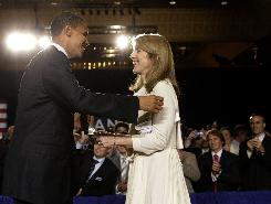 Democratic presidential candidate Sen. Barack Obama greets Caroline Kennedy at a July fundraiser in New York. Obama raised $52 million last month, but he must keep pushing for cash since he rejected public financing for this campaign.