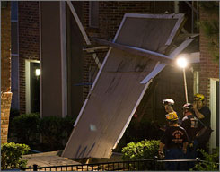 Houston Fire Department investigators check the scene of a balcony collapse at the Westwood Fountains apartment complex Wednesday in southwest Houston.
