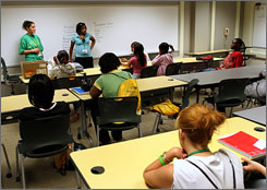 Teacher Tracy Linder, back left, leads a discussion on science at the Summerbridge program held at Wright State University in Fairborn, Ohio. The director of Summberbridge said she had to cut the budget by half this year.