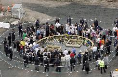 Family members of the victims of the attacks on the World Trade Center in New York place flowers at the reflecting pool at ground zero on the sixth anniversary of the attacks in 2007. New York City officials, who had said 2007 would be the last year families would be allowed into the site, confirmed Friday that the families will now be allowed to descend to the base of the trade center towers this Sept. 11, as in past years.