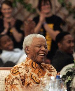 Former South Africa's President Nelson Mandela welcomed hundreds of well-wishers in a festive tent outside his home Saturday for a formal celebration of the anti-apartheid icon's 90th birthday.