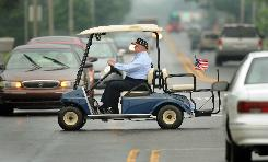 Larry Terwillegar, City Council president of Gas City, Ind., uses an electric golf cart to get around.