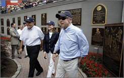 John McCain walks with former GOP rival Rudy Giuliani, left, and his wife, Judith Giuliani, before Sunday?s Yankees game.