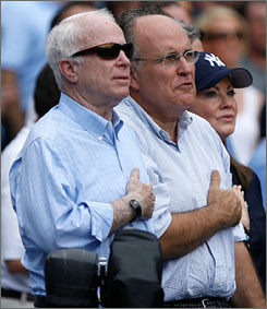 Republican presidential candidate Sen. John McCain and former New York City Mayor Rudy Guiliani stand for the National Anthem Sunday at Yankee Stadium in New York.
