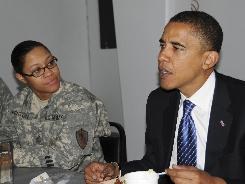 Sen. Barack Obama, seen here with Sgt. 1st Class Ishanna Fenton of Combined Security Transition Command, visited Camp Eggers in Kabul, Afghanistan, on Sunday.