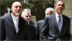 Democratic presidential contender Sen. Barack Obama, right, walks with Afghan President Hamid Karzai prior to a meeting at the presidential palace in Kabul on Sunday.