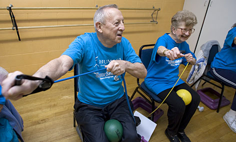 Andrew Dancy, 80, left, and his girlfriend Dorothy Trunda, 81, participate in the SilverSneakers program at the YMCA in Berwyn, Ill.