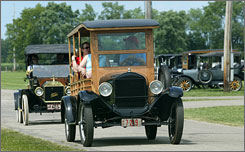 Ford Model T's arrive at the Model T Ford Centennial T Party at the Wayne County Fairgrounds in Richmond, Ind. on Monday. Over 600 had arrived on Monday, with over 900 expected before the event ends on July 26, 2008.  It is expected to be the largest gathering of Model T's in the United States.