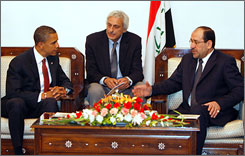 Democratic presidential contender Barack Obama, left, the senator from Illinois, met Monday with Iraqi Prime Minister Nouri al-Maliki, right, in Baghdad. In the middle is an unidentified aide.