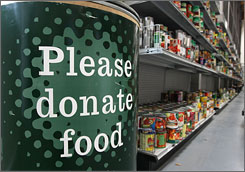 A bin solicits donations at the San Francisco Food Bank. Agencies nationwide report a drop in donations and an increase of people needing help.