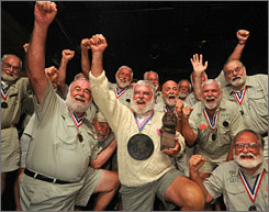 "Tom Grizzard lifts his trophy after winning the 2008 ""Papa"" Hemingway Look-Alike Contest in Leesburg, Fla. Saturday."