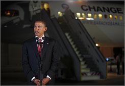 Democratic presidential candidate Barack Obama gives a speech in front of his campaign jet upon his arrival to Israel at Ben Gurion International Airport near Tel Aviv.