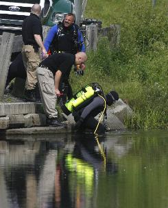 A diver enters Sunset Lake in Brookfield, Vt., as police search June 27 for Brooke Bennett, whose disappearance prompted the state's first-ever Amber Alert. Researchers say the number of alerts issued has decreased in recent years, as law enforcement agencies reserve their use for the most serious cases.