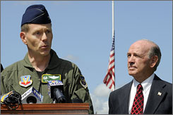 Second Bomb Wing Commander Col. Robert Wheeler delivers a solemn address to identify the six victims of the B-52 crash which occurred near Andersen Air Force Base in Guam during a news conference at the Barksdale Air Force Base in Bossier City, La. on Wednesday. Bossier City Mayor Lo Walker is at right.