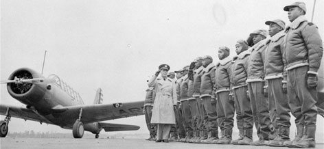 Major James A. Ellison, left, returns the salute of Mac Ross of Dayton, Ohio, as he inspects the cadets at the Basic and Advanced Flying School for Negro Air Corps Cadets at the Tuskegee Institute in Tuskegee, Ala.