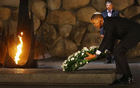 Barack Obama lays a wreath Wednesday in Jerusalem at the Yad Vashem Holocaust.