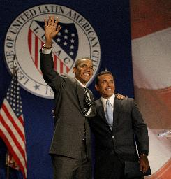 Democratic presidential candidate Sen. Barack Obama, D-Ill., left, and  Los Angeles Mayor Antonio Villaraigosa greet the audience July 8  at the League of United Latino American Citizens in Washington.
