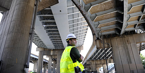 Jim Struzzi with the Pennsylvania Transportation Department stands under the Marshall Avenue Interchange bridge in Pittsburgh. The span is showing its 46 years of traffic and stress.