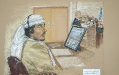 Defendant Salim Hamdan attends his trial July 22 inside the war crimes courthouse at Camp Justice, the legal complex of the U.S. Military Commissions, at Guantanamo Bay U.S. Naval Base, in Cuba.