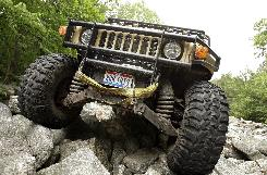 John Andres drives his H1 Hummer over rocks at the Hummer Club's Straight Up or On The Rocks gathering at the Rausch Creek Off-Road Park in Tremont, Pa.