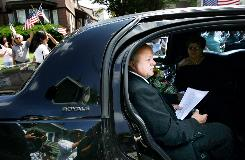 As the motorcade carrying the remains of his son, Alex Jimenez, stops in front of his home, the slain soldier's father, Andy Jimenez, composes himself before speaking to the media in Lawrence, Mass.