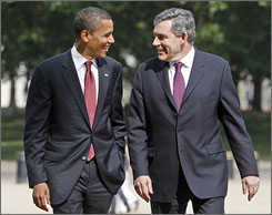 Democratic presidential candidate Senator Barack Obama, D-lll., left, talks with British Prime Minister Gordon Brown as they walk in Horseguards Parade behind the prime minister's official London residence No. 10 Downing Street.