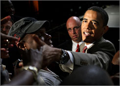 Democratic presidential candidate Barack Obama greets attendees at the Unity: Journalists of Color convention Sunday.