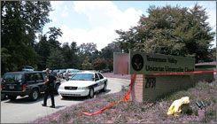 Police cordon the entrance to Tennessee Valley Unitarian Universalist Church in Knoxville, Tenn., on Sunday after a gunman entered the church and began shooting, leading to the deaths of two people.