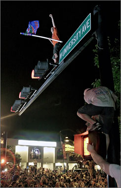 Gator fans climbed traffic lights and cheered in Gainesville, Fla., after Florida defeated UCLA 73-57 in the 2006 NCAA basketball championship. Florida wrested the party title away from West Virginia University in the Princeton Review on Monday.