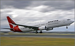 A Qantas Boeing 737-800 takes off into a storm from Sydney International Airport in June. A Qantas jet was forced to make an emergency landing at Adelaide airport Monday night because of a mechanical problem during a flight to Melbourne, reports said.