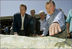 Robert Stine, right, examines a mockup of a vast nature preserve with Arnold Schwarzenegger.
