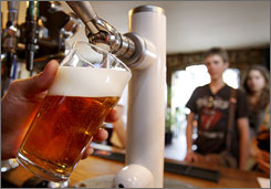 A bartender pulls a pint of beer in London on Monday. The iconic British pint is fast losing ground as the national drink, with a report out Monday showing beer sales in pubs slumping to their lowest level since the Great Depression.