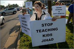 Christine Brim protests the Saudi Islamic Academy in Alexandria, Va., June 17.