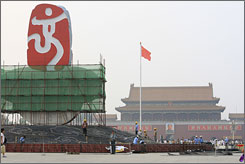 A display for the 2008 Beijing Summer Olympics is constructed July 26 on Tiananmen Square in China. The square is being decorated for Olympic celebrations.