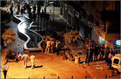 Forensic officers investigate the scene July 27 of two bomb explosions in a busy shopping district in Istanbul.