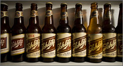 A variety of antique Schlitz beer bottles are seen from the collection of Leonard Jurgensen in Oconomowoc, Wis. That beer with the old-time mystique is back on shelves in bottles of its original formula in the city where it was first brewed more than a century and a half ago.