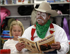Rodeo clown Starvin' Marvin Nash reads an anti-bullying book with third-grader Journey Hogan at Henderson Elementary School in Cheyenne, Wyo.